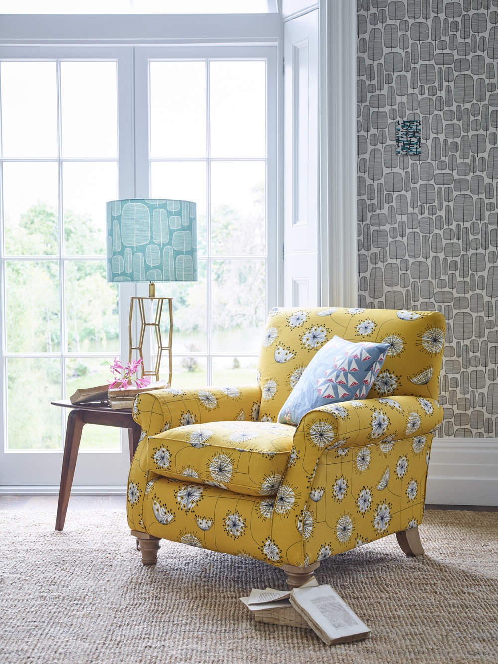 "Halstead Chair in Dandelion Mobile Sunflower Yellow and White Fabric £889, 17"" Scatter in Foxglove Tiki Fabric £59."