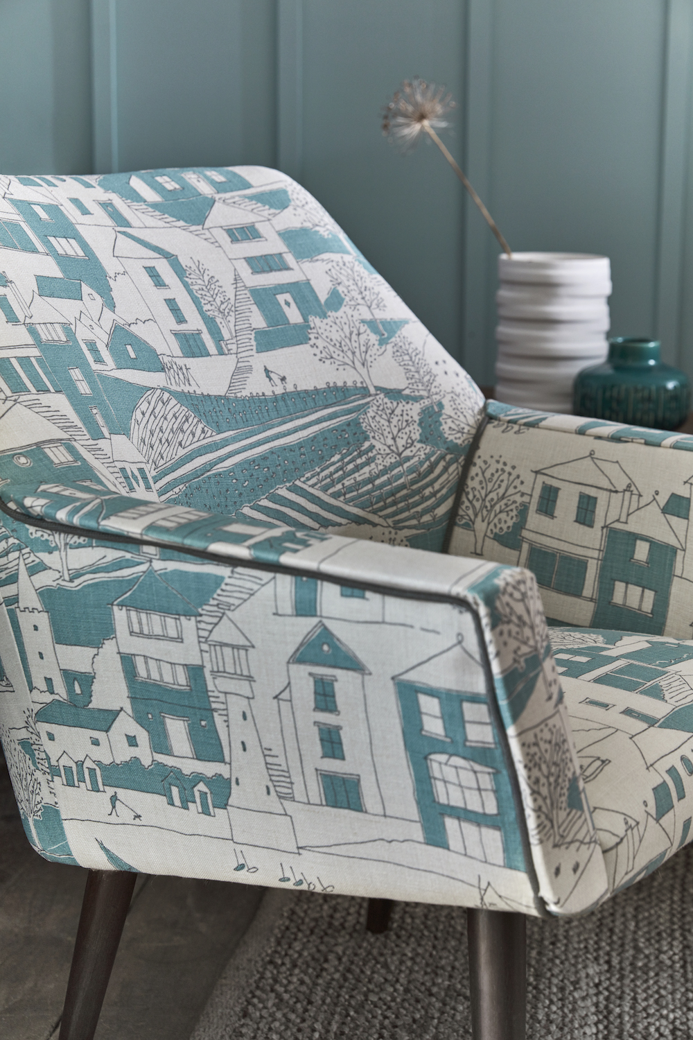 RETRO CHAIR: By the Sea Teal, Charcoal SEA-20-38 £52/mtr piping Plain Linen Charcoal PLAIN-38 £48/mtr. RUG: Handmade Looped by Scumble Goosie £49 each. PAINT: Brighton 203 by Little Greene Paint Company £42 per 2.5 ltr.