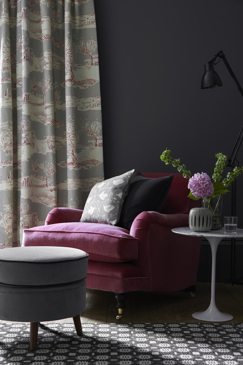 CURTAIN: For the Love of Rose Clay, Damson LOVE-37-45 £54/mtr; TRADITIONAL CHAIR: Rose Velvet VELVET-76 £58/mtr; CERNEY FOOTSTOOL: Elephant Velvet VELVET-75 £58/mtr piped in Thunder Velvet VELVET-74 £58/mtr; Cushion (back): Self piped and zipped Thunder Velvet VELVET-74 £58/mtr; CUSHION (front): Branching Out Scree BRANCH-67 £52/mtr piped in Plain Linen Charcoal PLAIN-38 £48/mtr; RUG: Dark Grey Tapestry by Solva Woolen Mill £99.75 each; PAINT: Scree 227 by Little Greene Paint Company £42, per 2.5 ltr