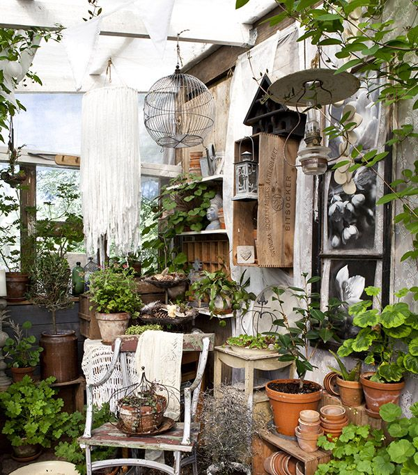 Terracotta pots, crate storage, rustic birdhouses and vintage lanterns transform a potting shed corner into a country gardener's retreat.    Shed Decor by Sally Coulthard is published by  Jacqui Small Publishing .