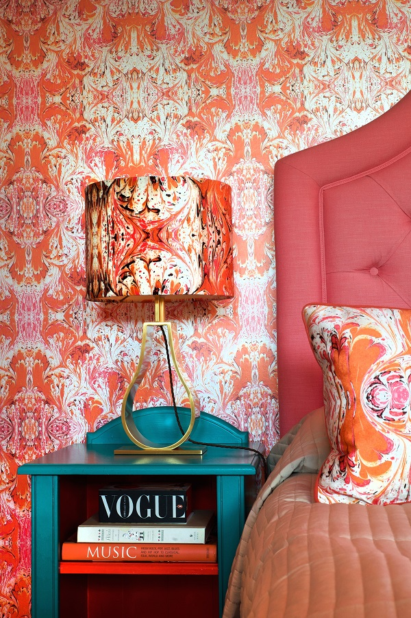orange feathered wallpaper, lampshade and cushion