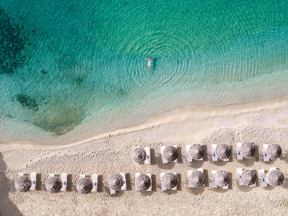 01-Mykonos-Blu,-World-Famous-Psarou-Beach_72dpi.jpg