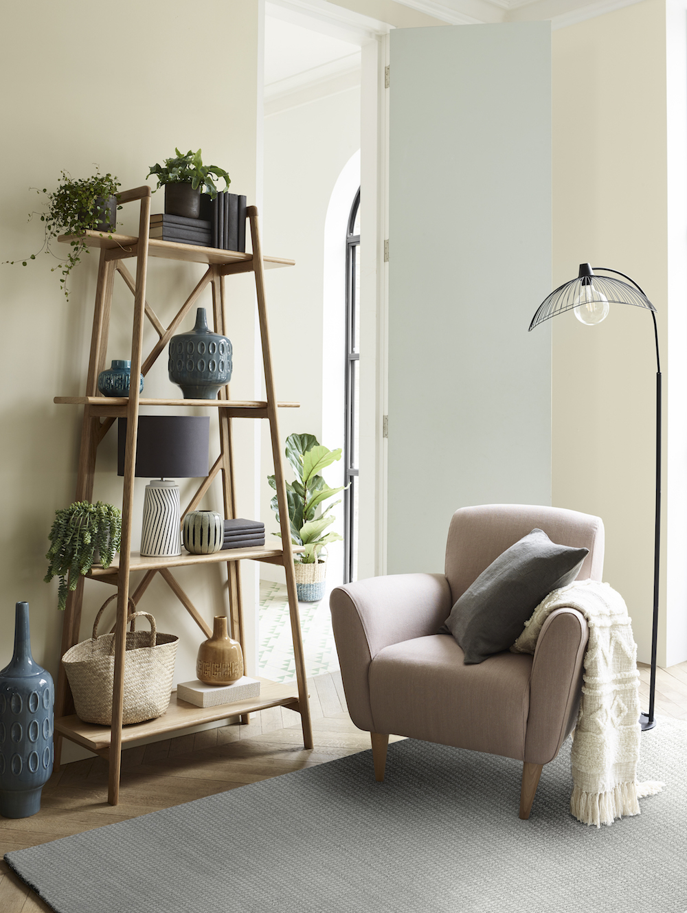 Albie Armchair, £499, Mantis Bookcase, £450, Hiko Floor Lamp, £140, Ziggy Table Lamp, £75