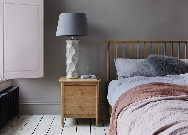 ercol Teramo Bedstead, £829; ercol Teramo Bedside Cabinet, £251; Raine Table Lamp, £149; Scatterbox Velour Cushion, £29; Mongolian Cushion, £49.