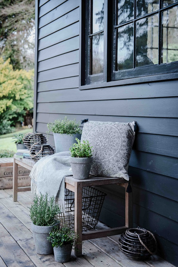 Rectangle Printed Emblem Cushion £12.99, Herringbone Throw £29.99, Rattan lantern £16.99, Various Herbs £3.99 or 3 for £10, all Dobbies Garden Centres  (Wire basket – stylists own)