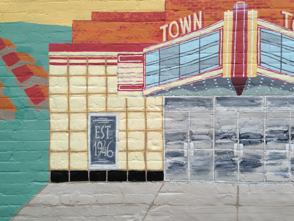 55 x 15 foot mural on textured brick, done with a historical theme about the Town of Highland.