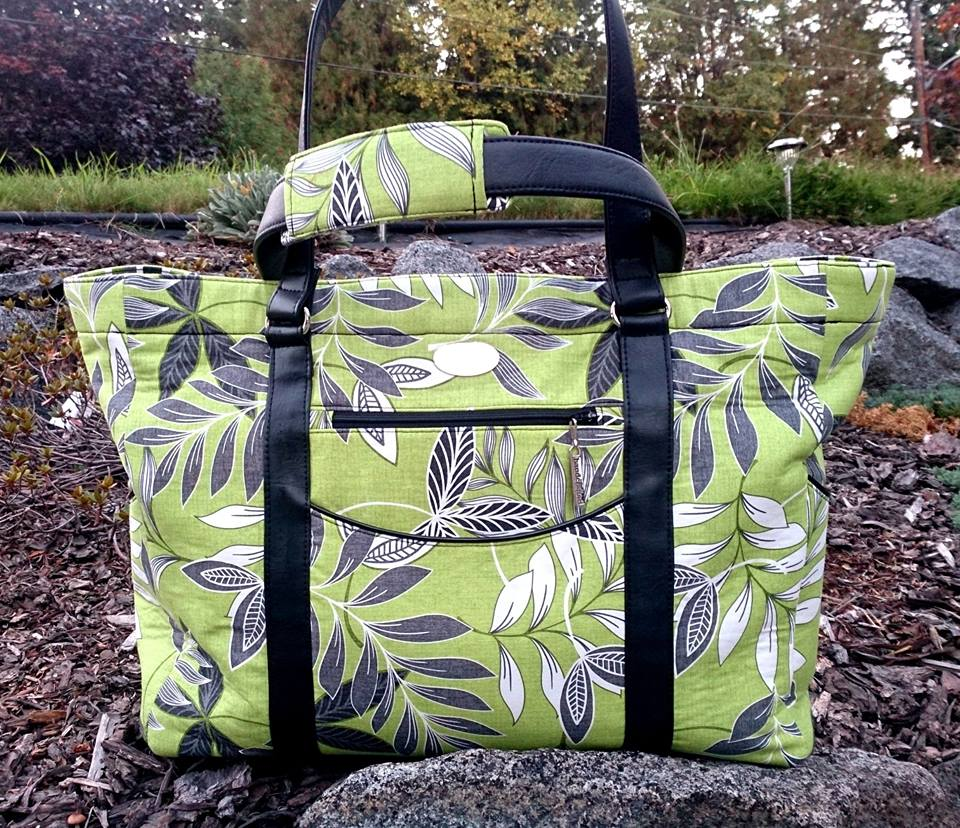 The black faux leather straps really look great with the green leaf print fabric.