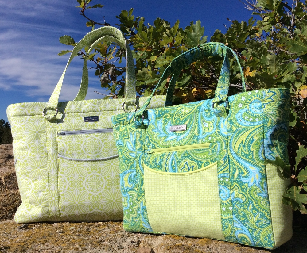 The Megan Travel Tote is on the left and the Sidekick Tote is on the right.