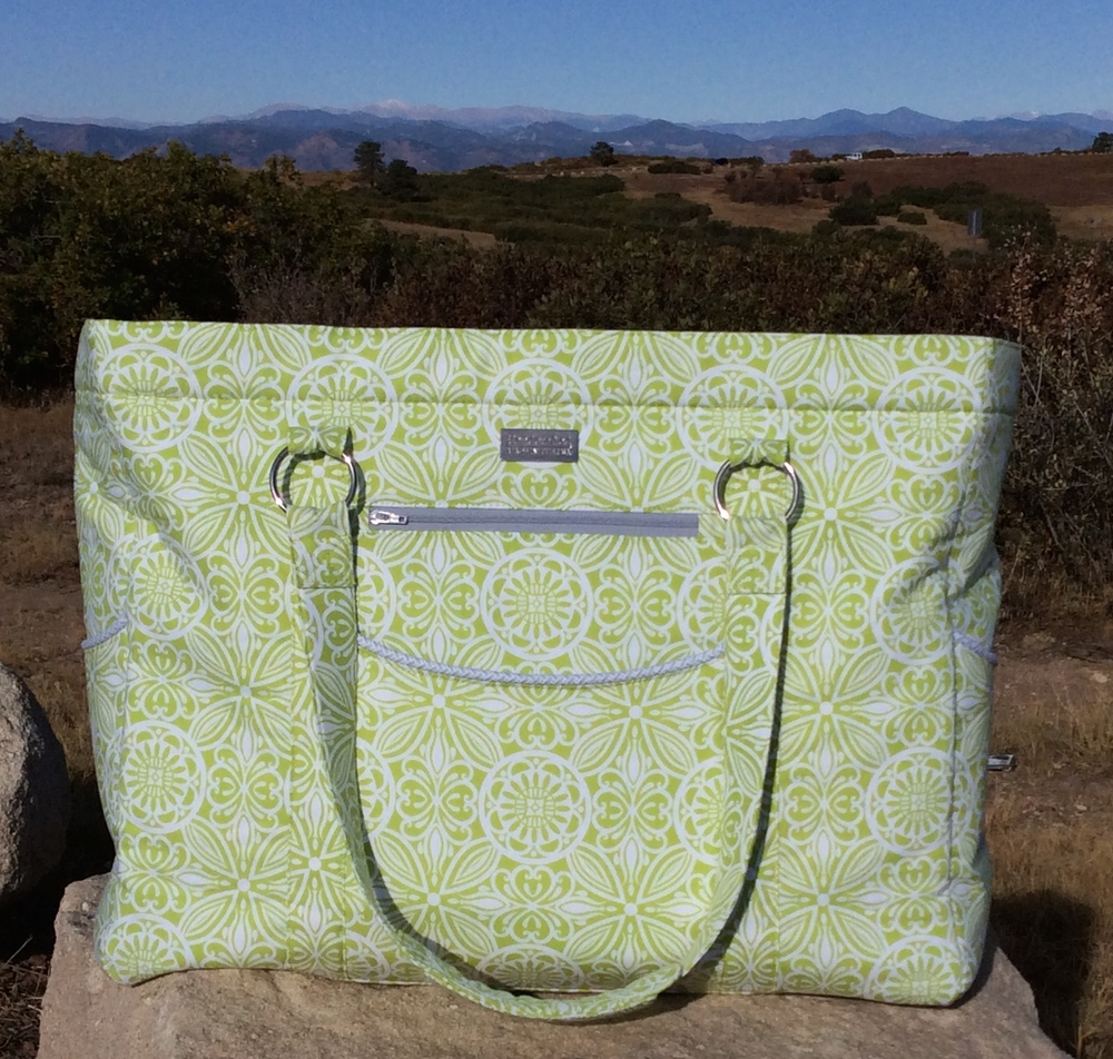 I think those mountains behind this Megan Travel Tote are calling! I think they are calling me! This pattern was a huge undertaking, so I might just have to pack up for a weekend getaway! ;)
