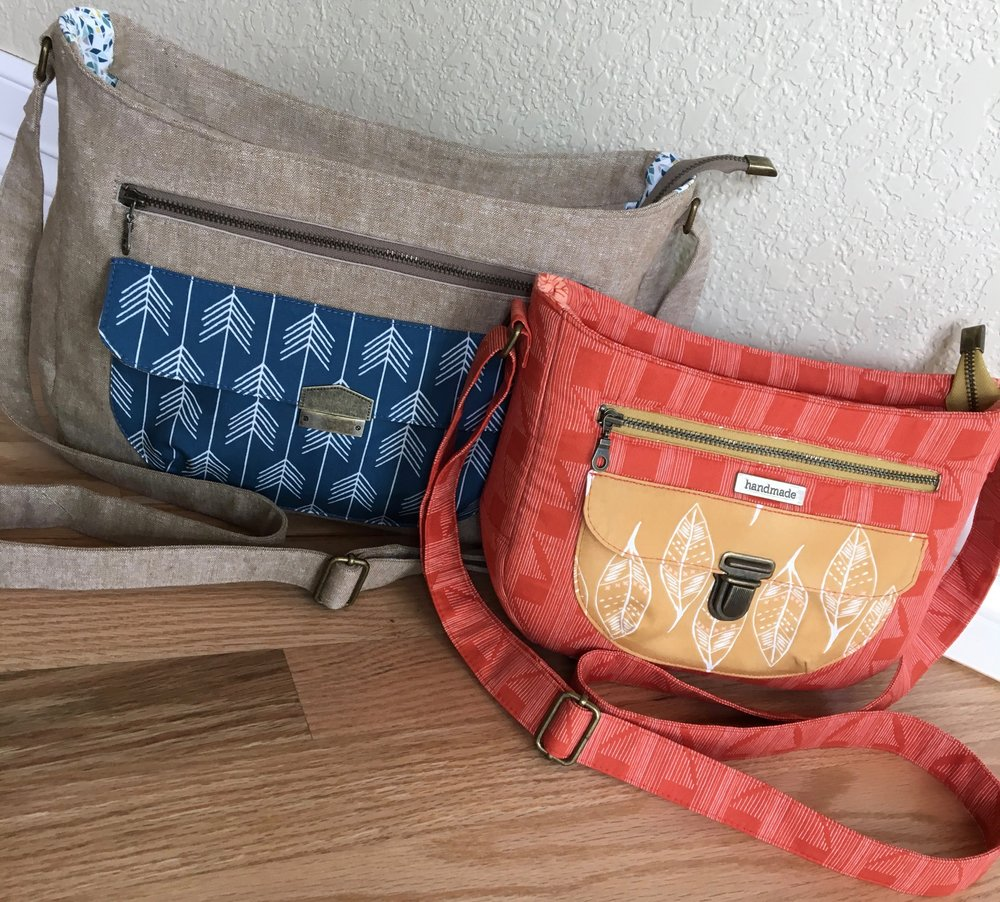 "The Aspen Crossbody Bag on the left is the large size - it has a  ""Snappy"" Edge Clasp  from Emmaline Bags for a pocket closure. The Aspen Crossbody Bag on the right is the small size. The small Aspen Crossbody has a  Tongue Lock  from Emmaline Bags for a pocket closure."