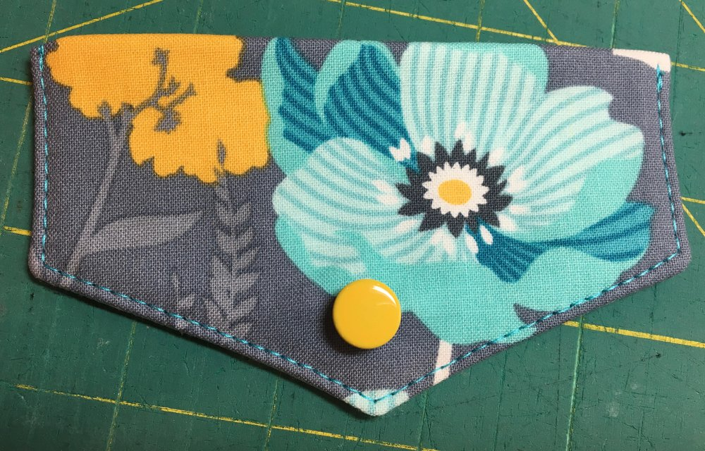 I installed a magnetic snap on this Kristine ID Wallet flap, but you can see what I mean about installing the male half of the snap through all layers if you have a pretty snap that you want to show off.