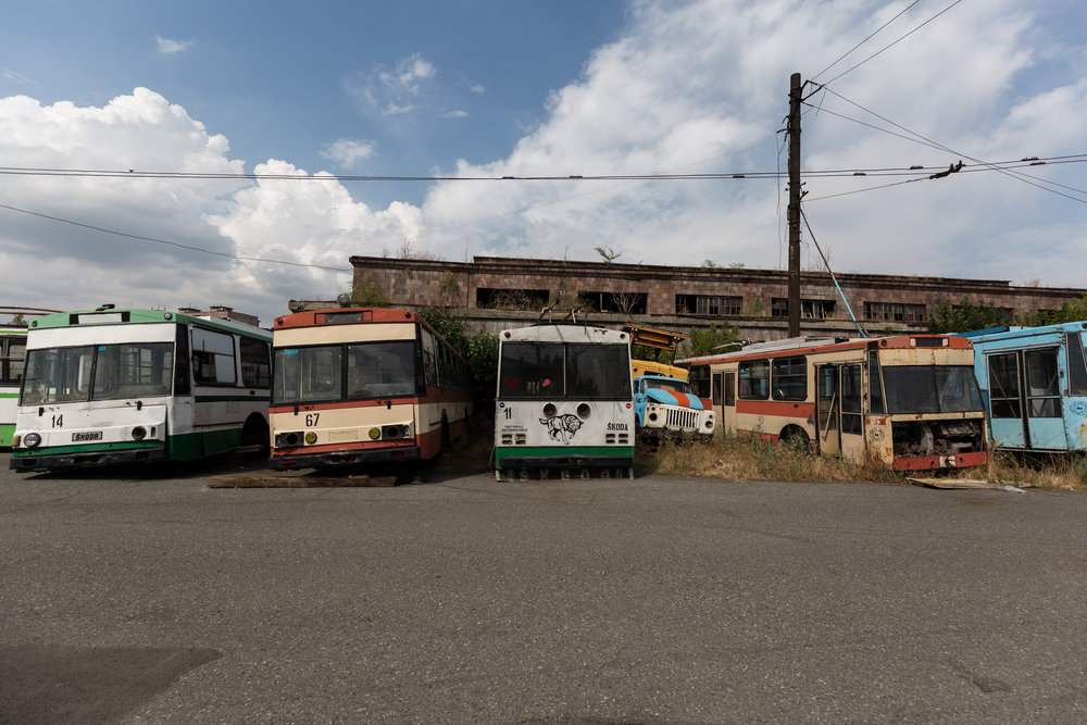 At the end of each day the trolleybuses are brought to this location to be stored and serviced. The massive empty lot is like a trolleybus graveyard with many left behind to rust or be stripped for parts. Some of the vehicles date back to the 1970s. Models range from the retired Czech Škoda 9Trs and Soviet ZiU-682s to Czech Škoda 14Tr, Russian LiAZ-5280, and French (Renault) Berliet ER100 from Lyon.