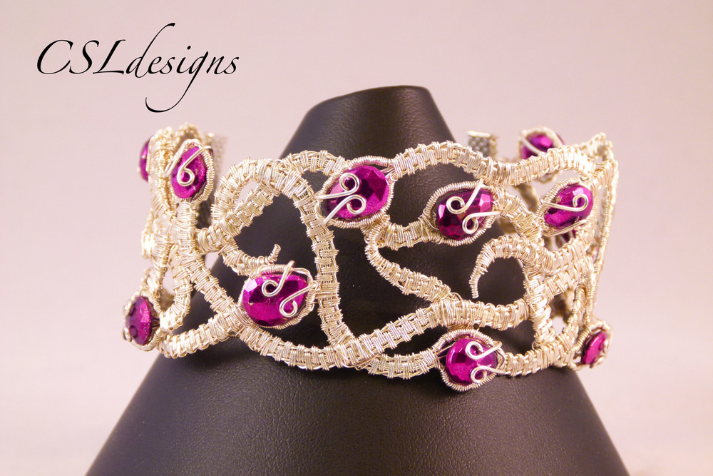 Wirework intertwining snake bracelet front close.jpg