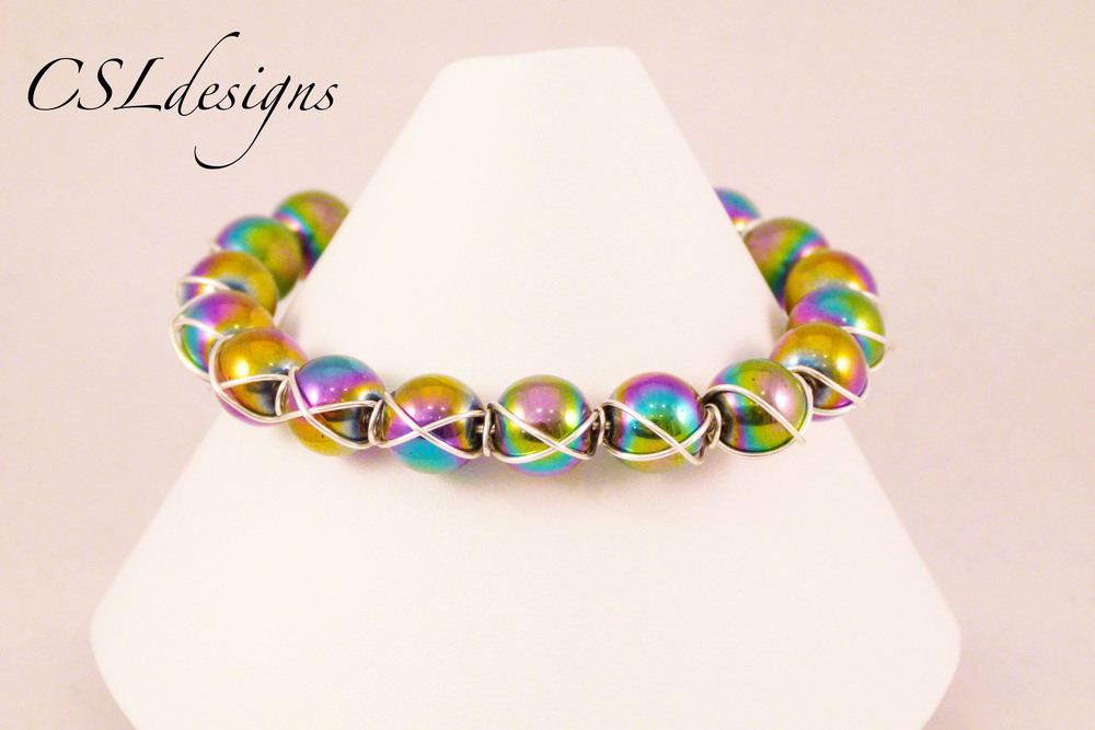Cross wire wrapped rainbow bracelet front close.jpg