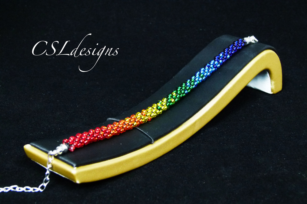 Rainbow beaded kumihimo braid lying down.jpg
