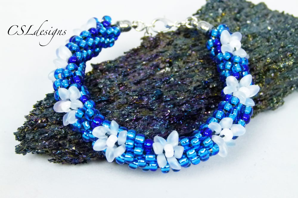 Frozen inspired beaded kumihimo bracelet.jpg