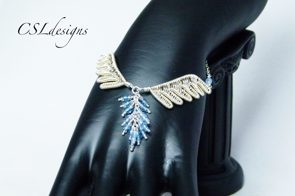 Wirework wings bracelet hand.jpg
