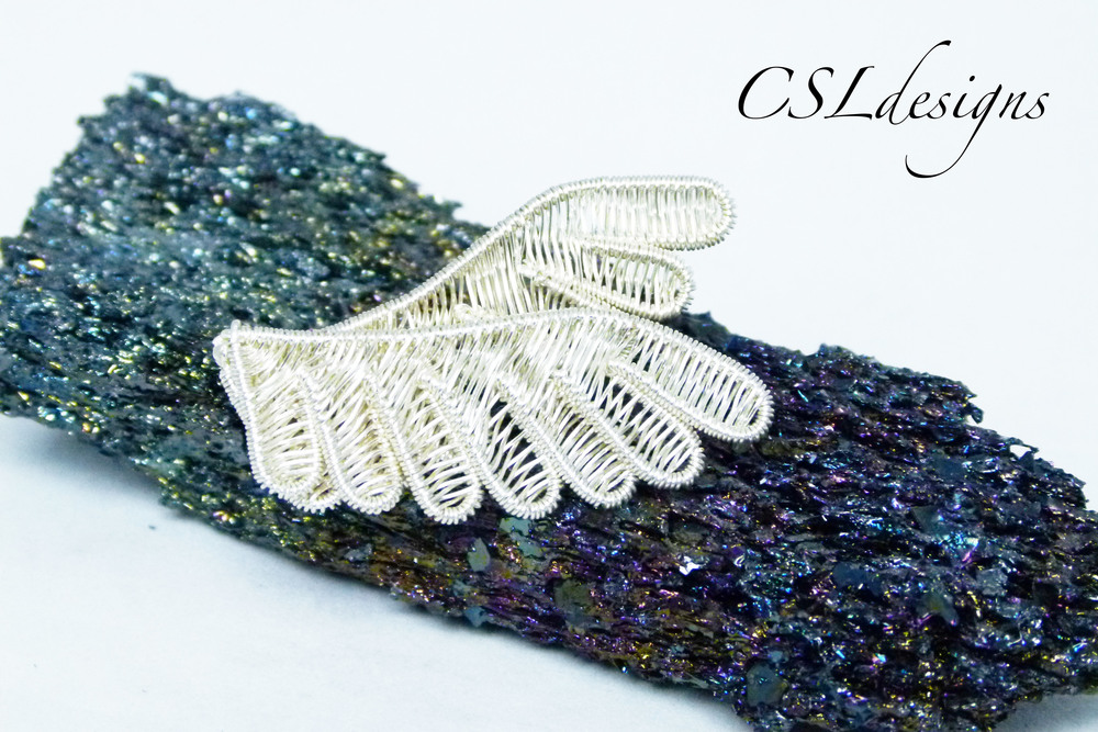 Wirework wings brooch front.jpg