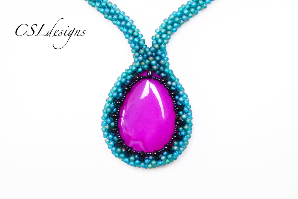 Beaded kumihimo cabochon SuperDuo pink stand front close.jpg