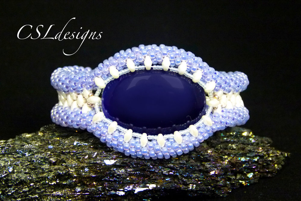 Captured cabochon beaded kumihimo bracelet thumbnail.jpg