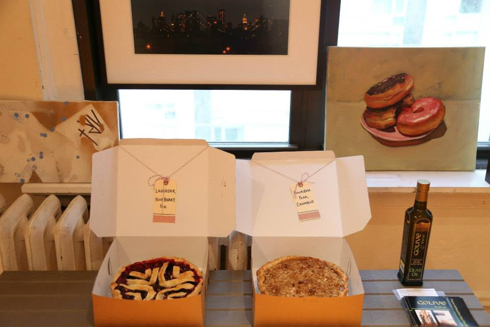 Some of our lovely silent auction items, including two delicious homemade pies and new GOLIVE Spartan Olive Oil