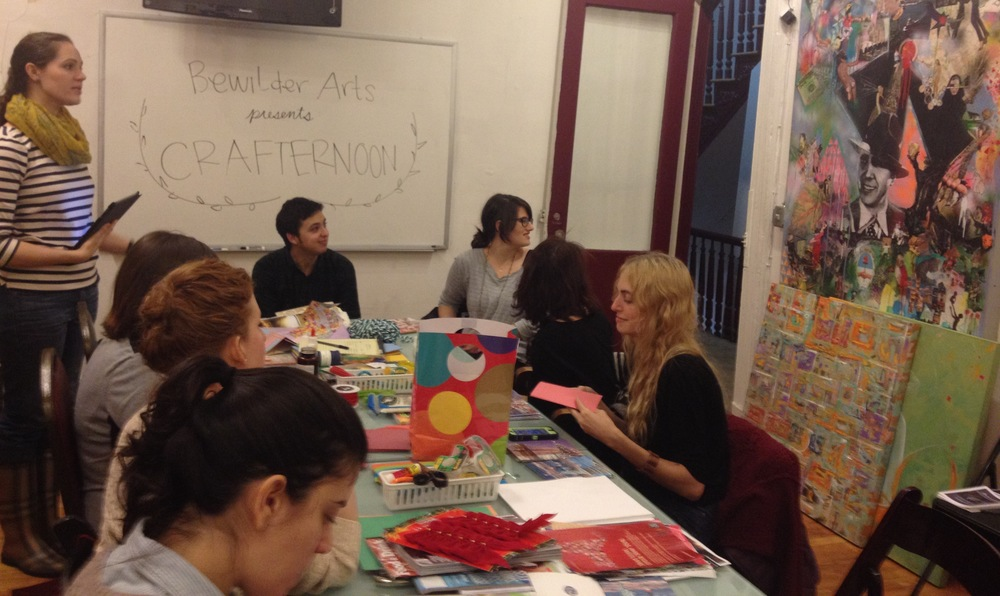 Madeline Epstein leading the crafters in a collage demonstratino
