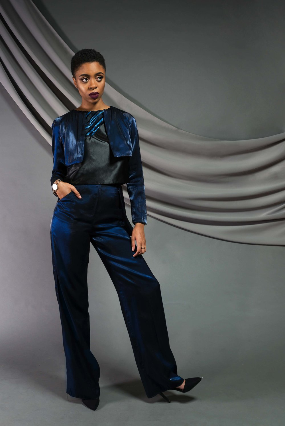 Cropped Flare Jacket:  Iridescent viscose   Embellished Top:  Sequin mesh, silk shantung   Wide leg pant:  Iridescent viscose