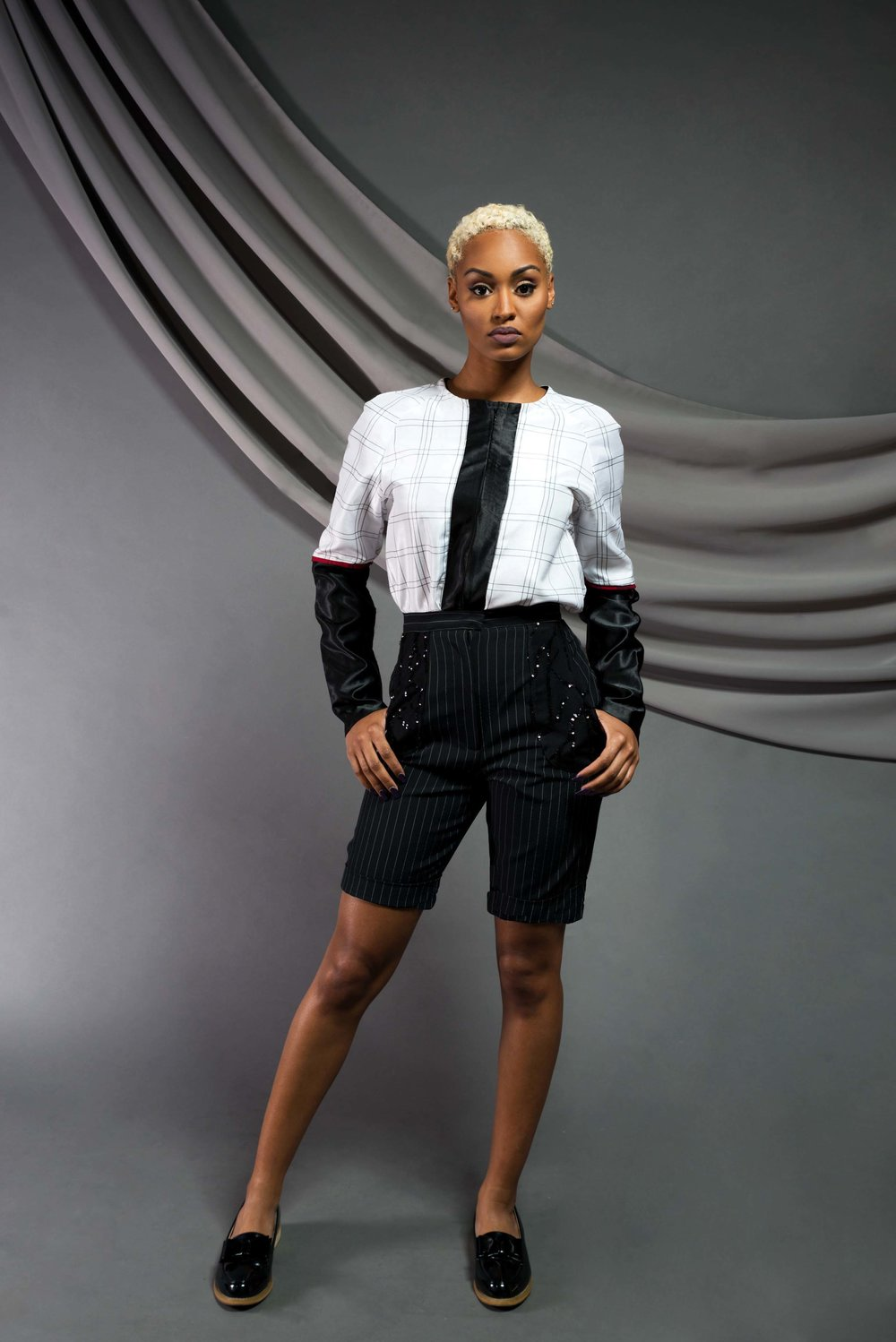 Long-sleeve Poker blouse:  Satin shantung, dupioni silk, viscose   Sequin Bermuda Shorts:  Wool suits, sequin mesh