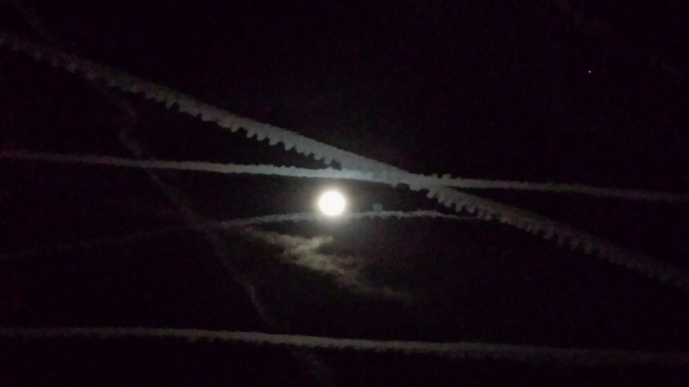 Moon and Contrails.jpg
