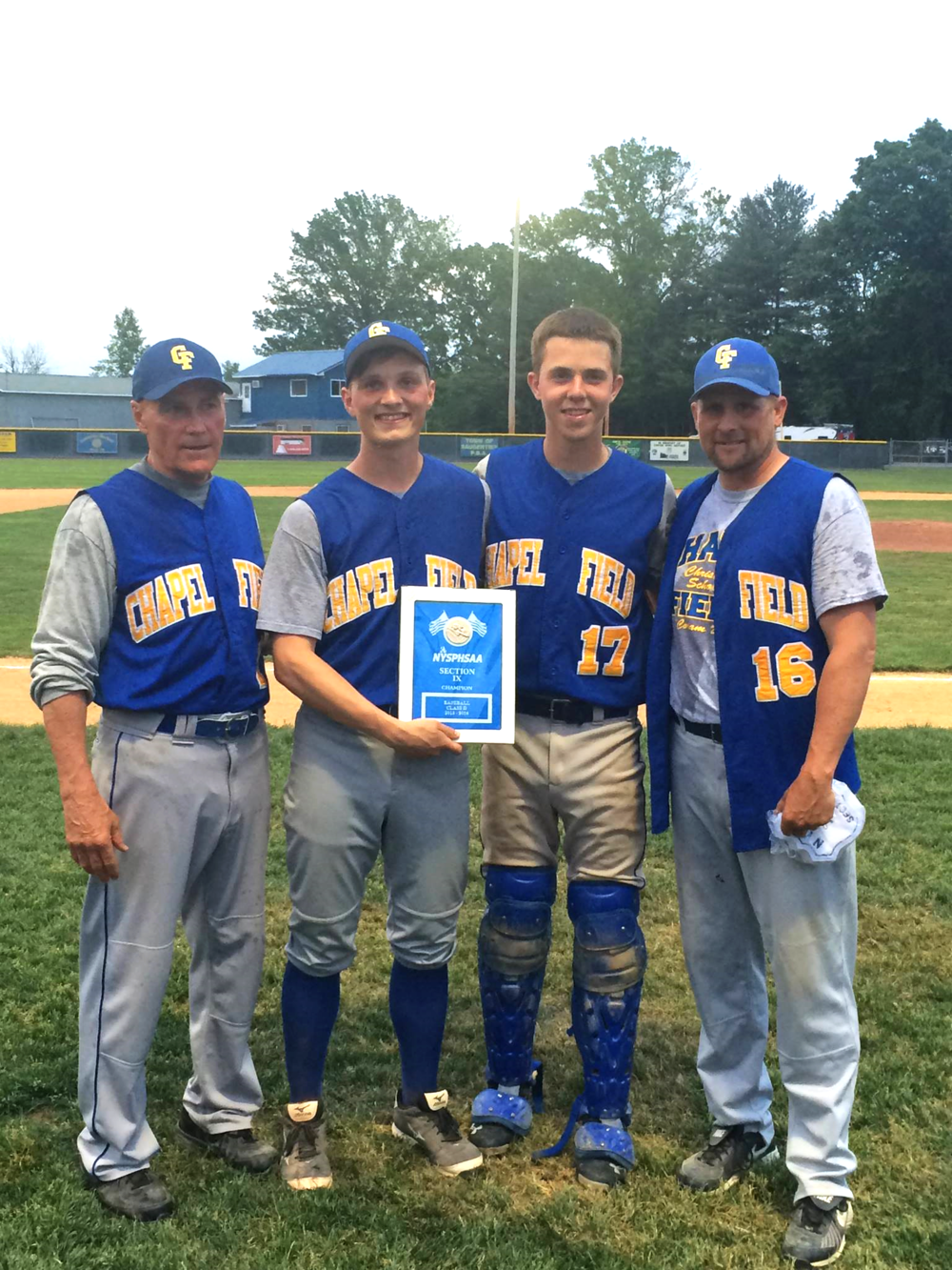 Captains Andy Spanjer and Ethan Jacobsen with coaches holding the Section 9 Championship plaque.