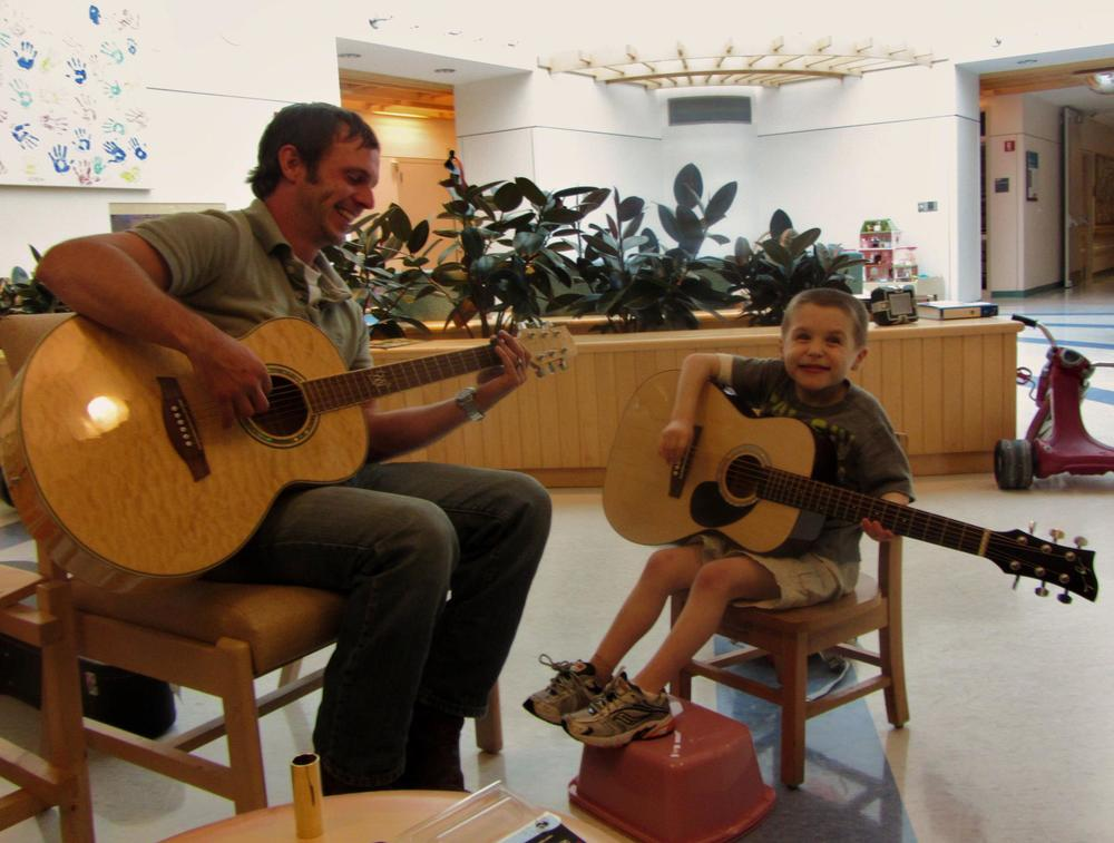 MCMA Director Tom Ulichny with a Raising the Blues student at the Barbara Bush Children's Hospital, 2012