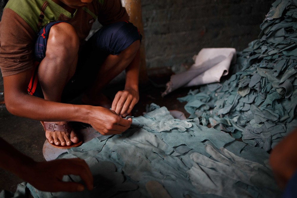 Al Amin, 20, works in a tannery dyeing leather goods. He says he is willing to move should the tanneries uproot but is unsure about the reality of finding a job when priority will likely be given to locals in the new area in Savar.