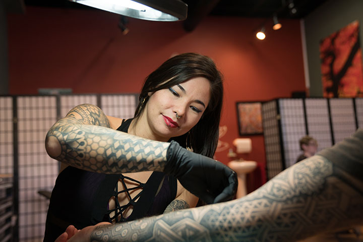 Kimi Leger, Owner Sacred Lotus Tattoo Shop  Photography by: Audrey Goforth