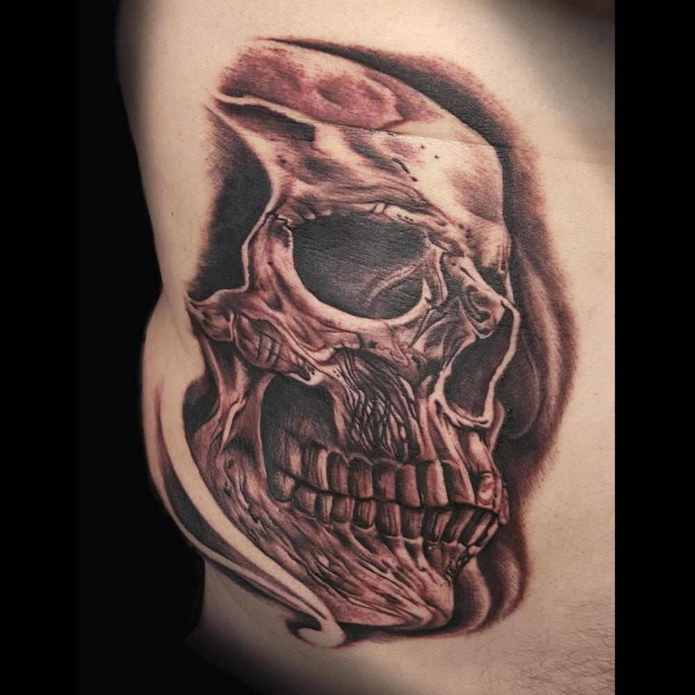 Kimi-Ledger-Tattoo-Asheville-Skull.jpg