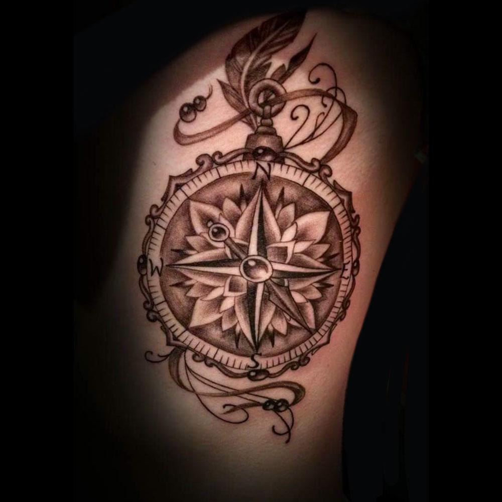 Kimi-Ledger-Sacred-Lotus-Tattoo-Asheville-Compass.jpg