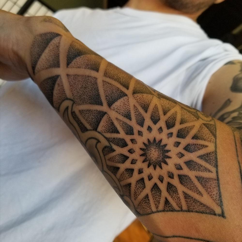 Kimi-Ledger-Sacred-Lotus-Tattoo-Asheville-Geometry.jpg