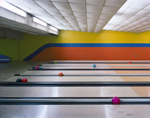 Andrew Moore, Bowling Lanes, Governors Island, NY, 2001, Chromogenic Print, 40 x 50 inches. Photo courtesy of the artist and Yancey Richardson Gallery.