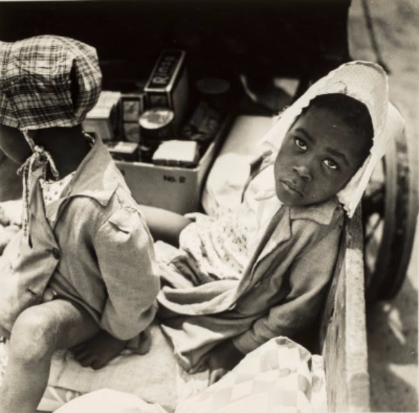Esther Bubley, Children waiting for their mother to finish shopping, 1945; Gelatin silver print, 11 x 14 in.; Gift of Robert and Kathi Steinke; © Standard Oil (New Jersey) Collection #26162; Photographic Archives, University of Louisville; Photograph by Lee Stalsworth