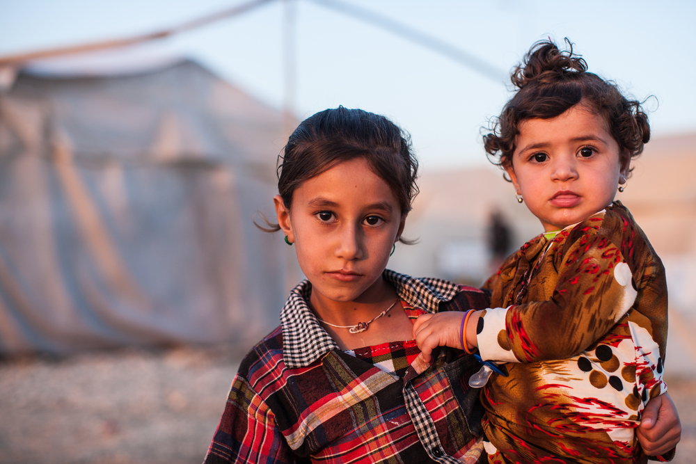 These sisters, of the Yezidi faith, lived in the Shariya camp for internally displaced persons in Dahuk, Iraq, in September 2015. Mackenzie Knowles-Coursin for the US Holocaust Memorial Museum