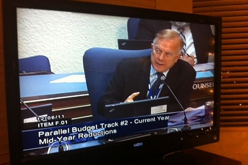 Phil Stover captured on TV presenting the trustees their options for mid-year budget reductions