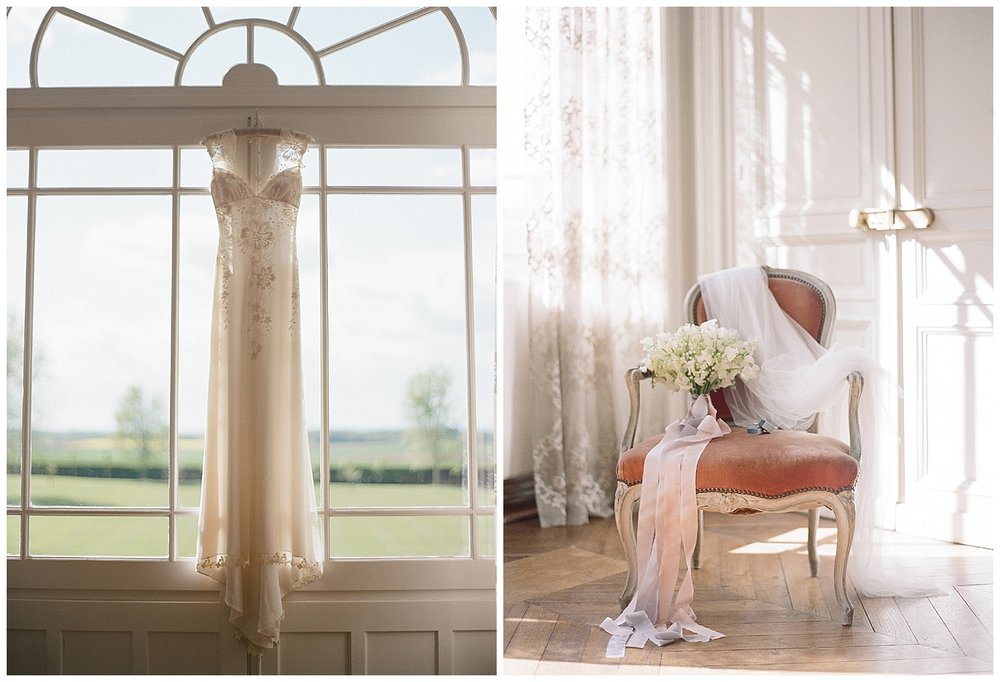 Wedding gown hangs in Chateau de Varennes window, bouquet and other wedding details; Sylvie Gil Photography