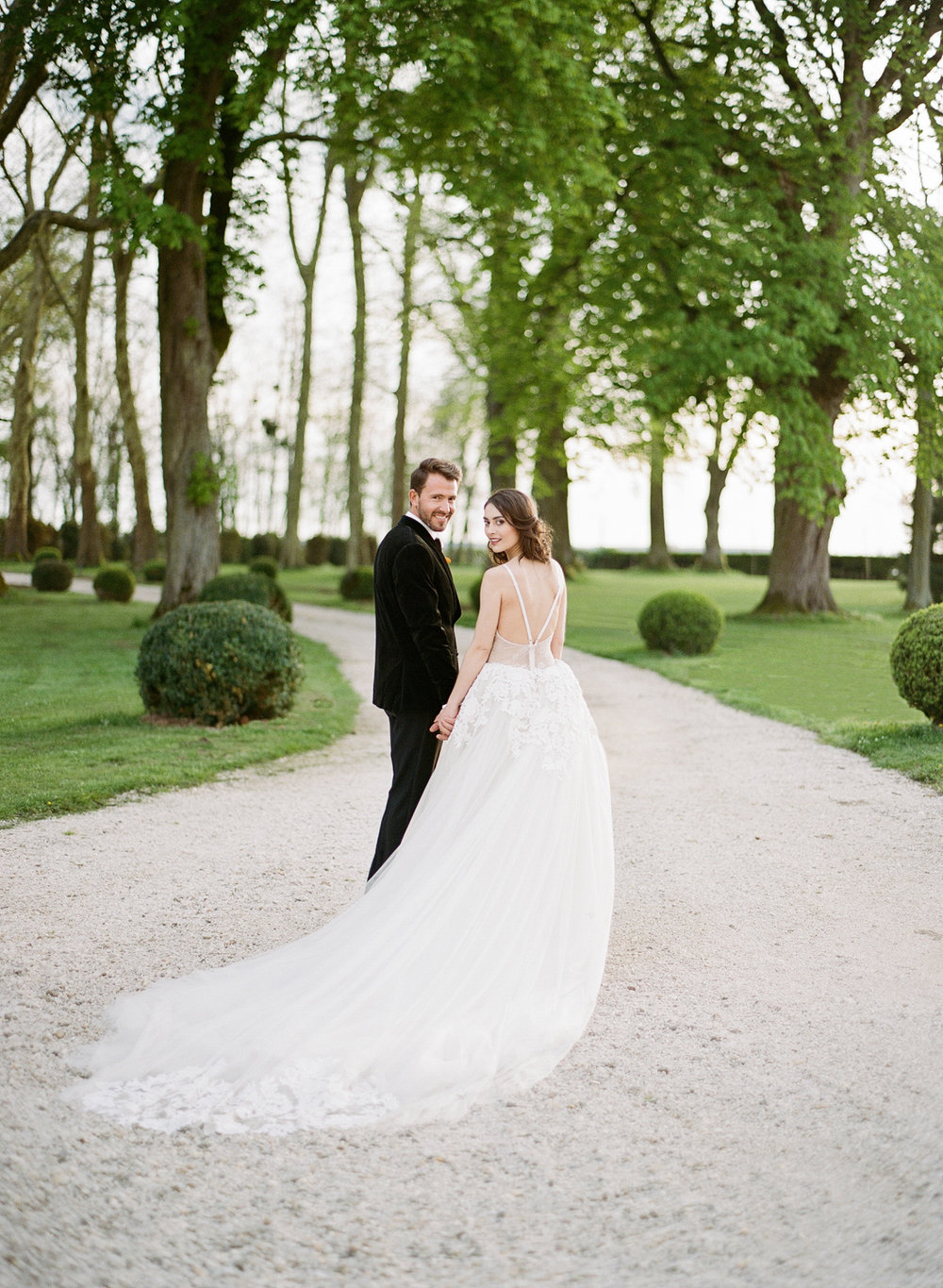 Driveway of Chateau de Varennes, bride wears a Vera Wang gown; Sylvie Gil Photography