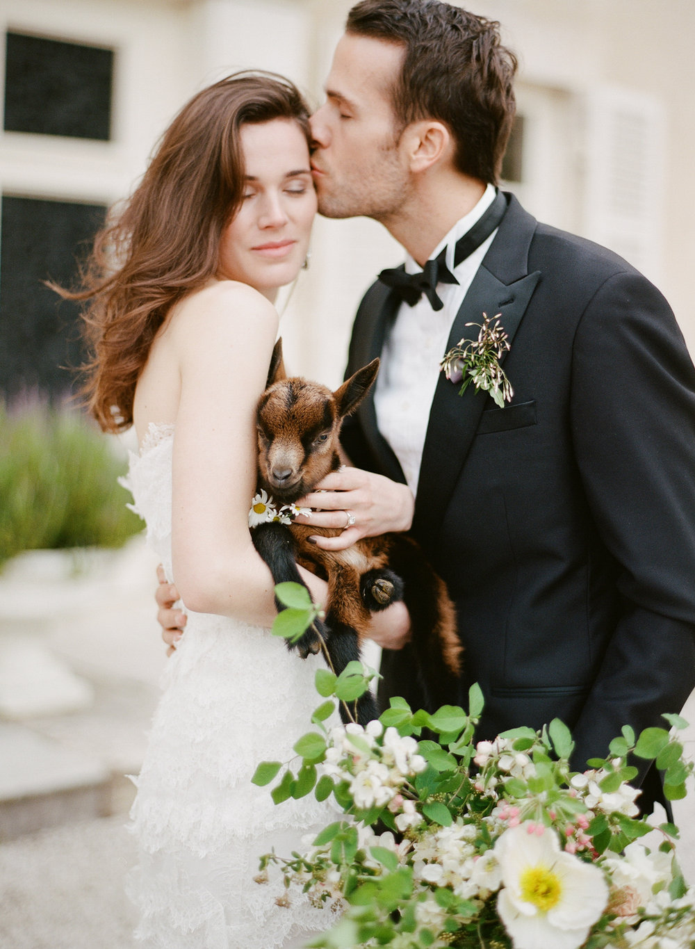 Bride holds a baby goat during a 2016 Workshop styled shoot; Sylvie Gil Photography