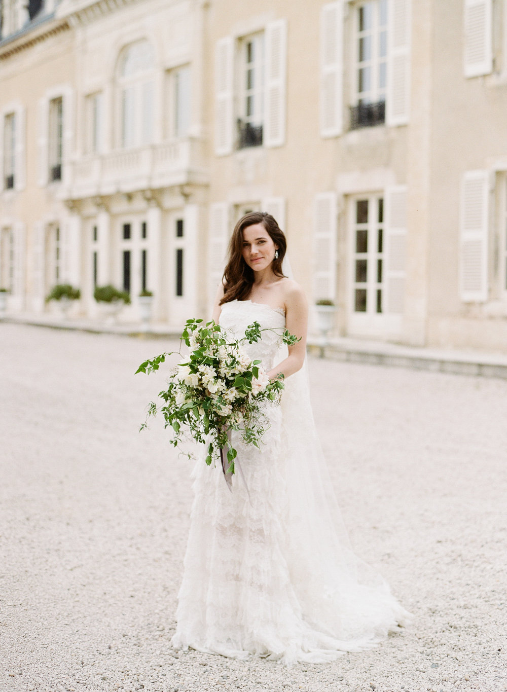Bride in front of Chateau de Varennes; Sylvie Gil Photography