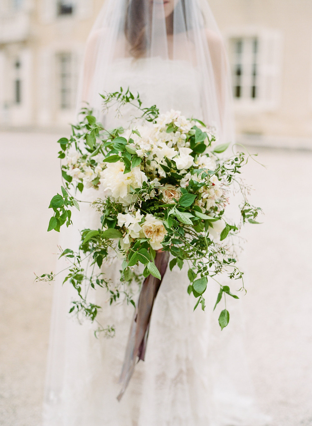 Bride with overflowing, rustic bouquet; Sylvie Gil Photography