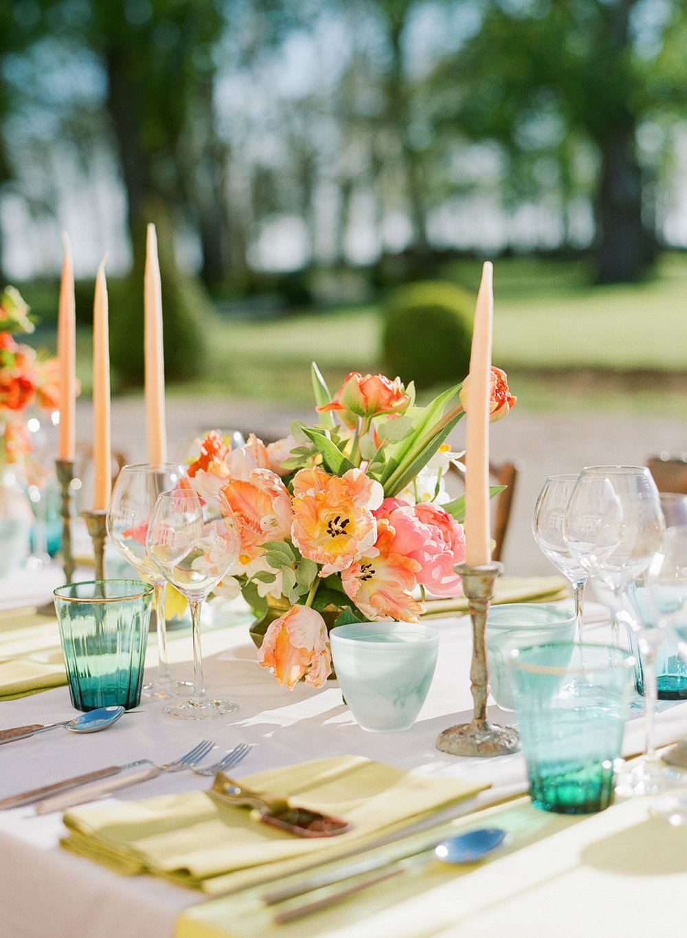 Peach and turquoise florals and tabletop accents; Sylvie Gil Photography