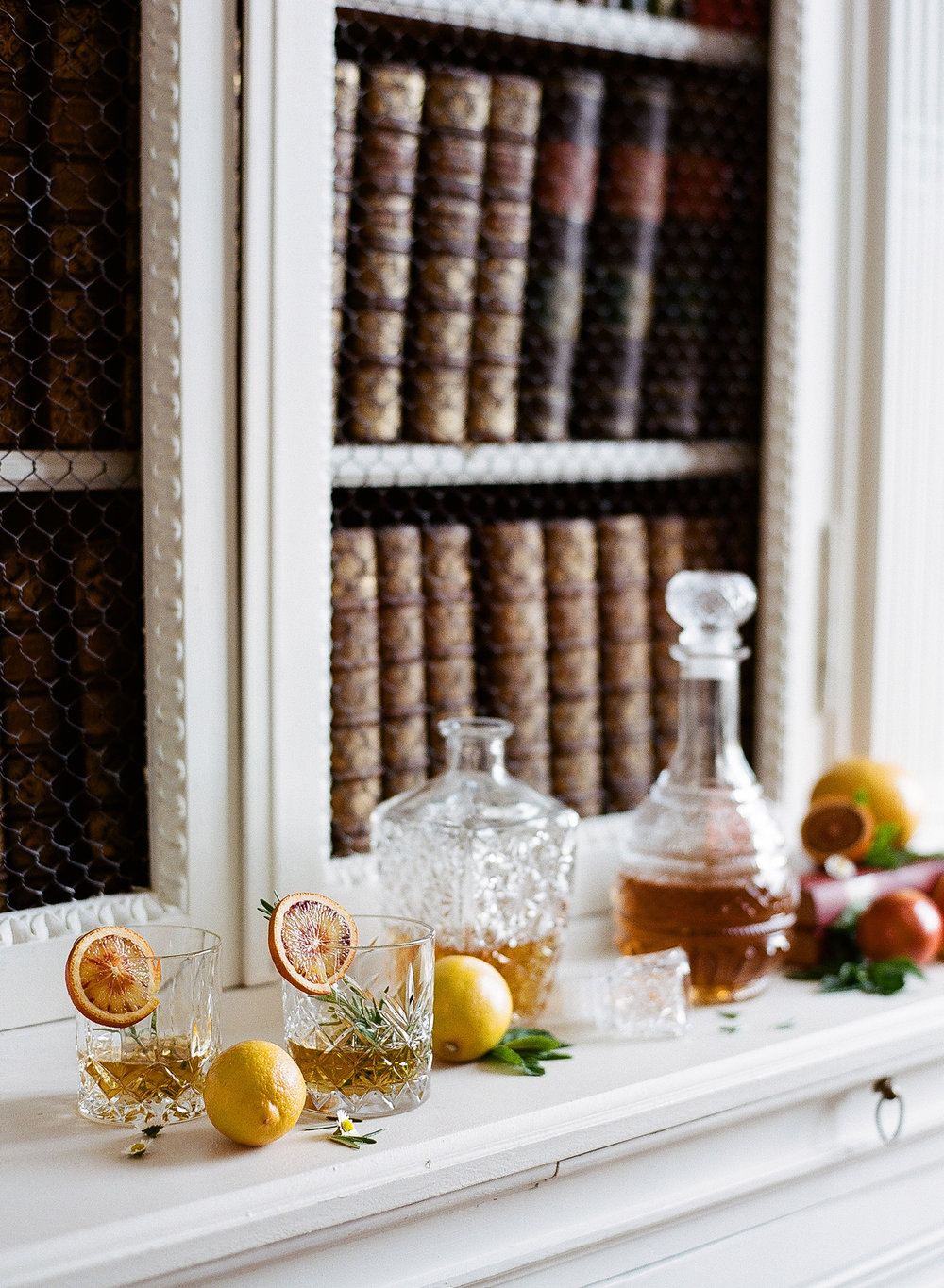 A bar shelf in the study at Chateau de Varennes in Burgundy, France; Sylvie Gil Photography