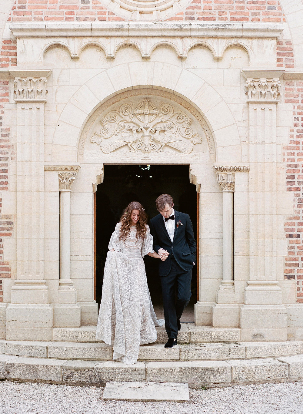 Bride and groom exit the Chateau de Varennes chapel, just married; Sylvie Gil Photography