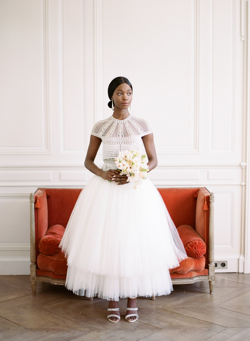 The bride in a Naeem Khan gown with a simple white bouquet at Chateau de Varennes; Sylvie Gil Photography
