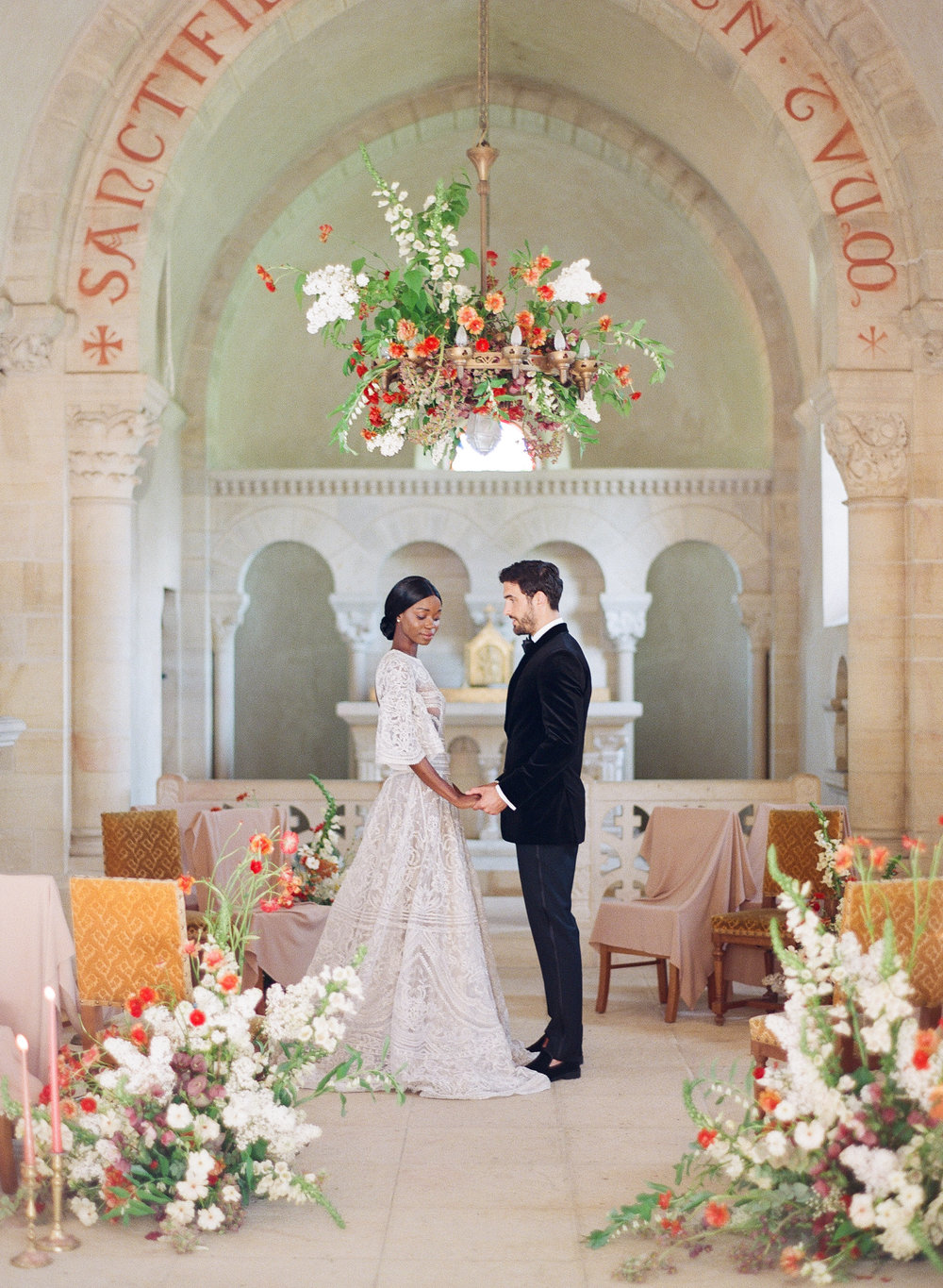 Bride and groom at an intimate wedding ceremony in the chapel of Chateau de Varennes; Sylvie Gil Photography